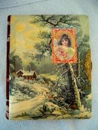 Antique celluloid photo album with winter scene and cameo portrait