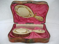 Celluloid dresser box with Gutta Percha mirror brush comb set