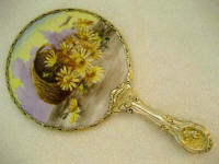 Antique Porcelain vanity hand mirror basket full of daisies