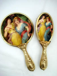 Celluloid mirror brush vanity set with Art Nouveau lady portraits