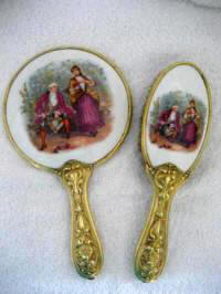 Antique Art Nouveau vanity mirror brush set porcelain backs with Colonial couple