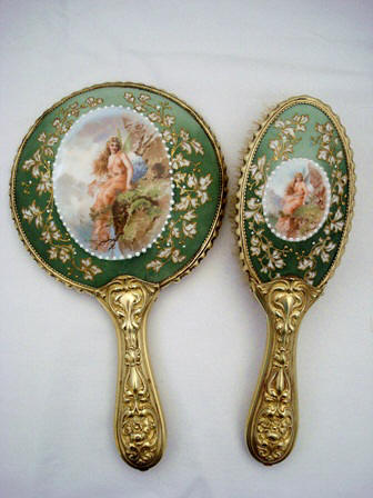 Antique Art Nouveau porcelain hand mirror brush vanity set winged lady on the cliff