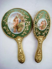Antique Art Nouveau hand mirror brush vanity set with fairy sitting on the cliff