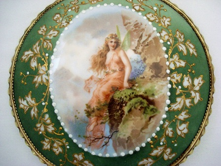 Art Nouveau porcelain backed hand mirror brush winged lady sitting on the cliff