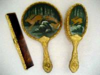 Rare porcelain backed hand mirror brush comb vanity set with unusual hunt scene and stunning gold gilt