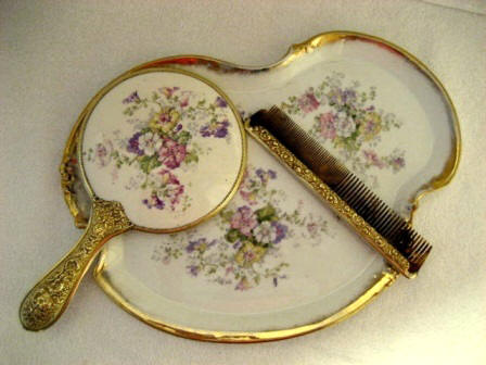 Antique Limoges hand mirror, matching dresser tray, hair comb set by William Guerin ca. 1900