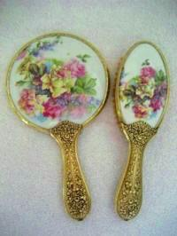 Antique Victorian vanity hand mirror brush set with large bouquet of pink yellow roses