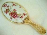 Late Victorian porcelain oval hand mirror with soft lavender violets