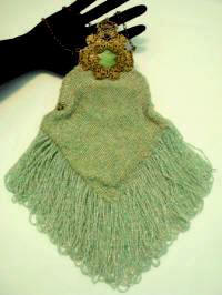 Antique beaded purse with Victorian filigree celluloid frame and long fringes