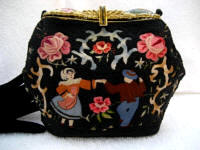 Vintage 1920 - 1930 French black beaded and embroidered evening purse with enameled frame