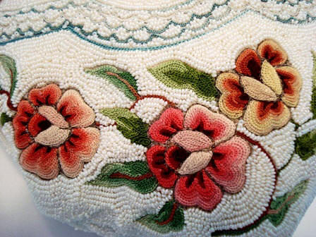 French figural embroidered handbag with Trapunto roses enameled frame