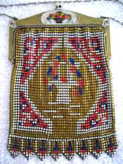 1920 Whiting Davis mesh purse enameled baskets of flowers on the frame